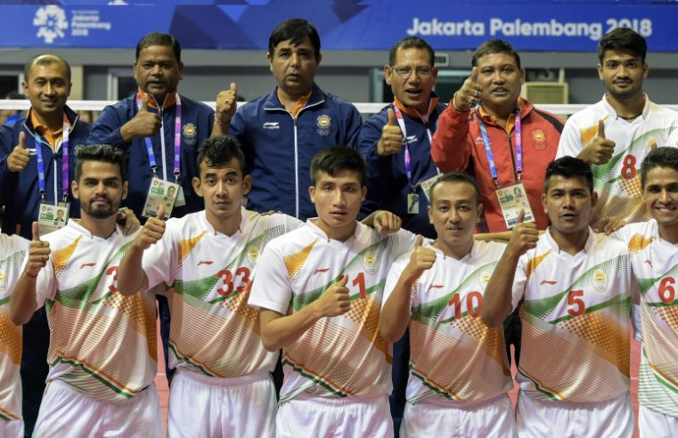 A Sepak-Takraw Team Showing Thumbs up After Their Victory.